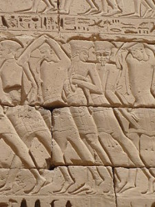 """Wall Relief of captives """"Sea People"""" at Medinet Habu I, Rémih [GFDL (http://www.gnu.org/copyleft/fdl.html), CC-BY-SA-3.0 (http://creativecommons.org/licenses/by-sa/3.0/) or CC BY-SA 2.5-2.0-1.0 (http://creativecommons.org/licenses/by-sa/2.5-2.0-1.0)], via Wikimedia Commons"""